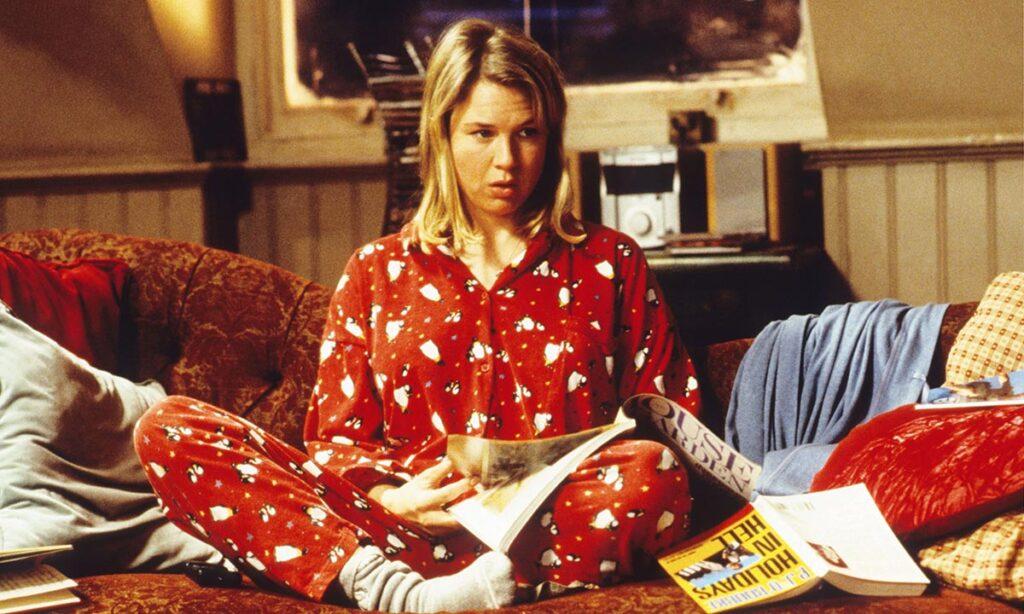 NE PLUS AVOIR PEUR DU VIDE INTÉRIEUR : Bridget Jones déprime en pyjama sur son lit.