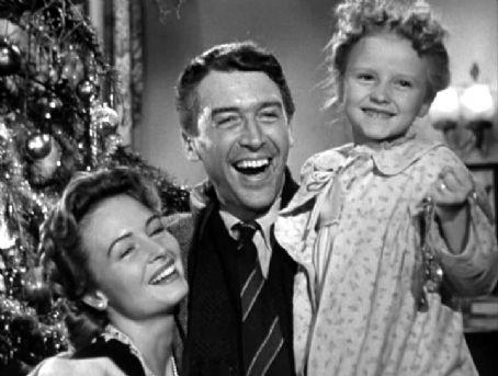 George Bailey heureux avec sa femme et sa petite fille